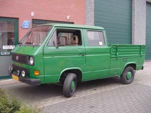 Groene VW T3 pick-up met dubbele cabine